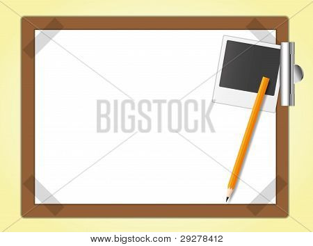 Drawing board and the master photo with pencil.