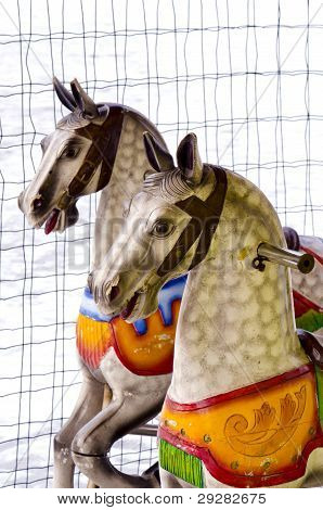 Two Carousel Horses In Winter Time