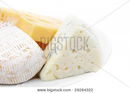 various types of solid french cheese parmesan brie and edam on white platter isolated on white background