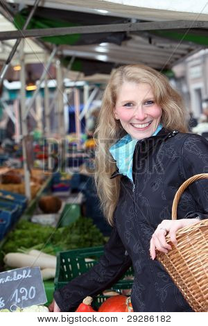 happy women with fresh vegetable