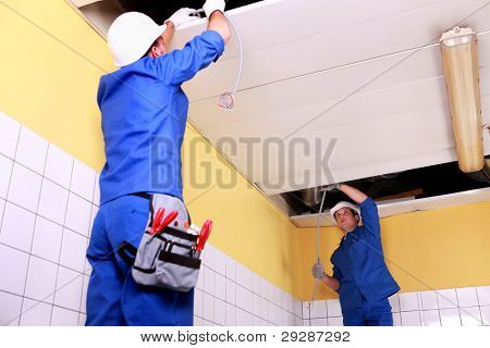 Two electrician inspection ceiling panels