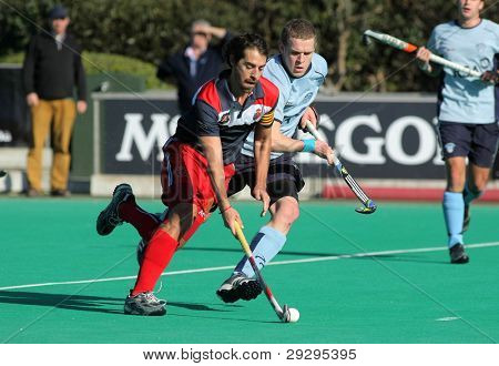 BARCELONA - JAN, 7: Alex Fabregas(L) of RC Polo during vies with David Cole(R) of Monkstown HC  a King's Trophy match at the RC de Polo pitch on January 7, 2012 in Barcelona, Spain