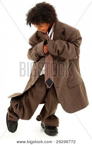 Adorable Beautiful Black Girl Child in Baggy Business Suit walking over white background.