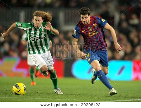 BARCELONA - JAN, 15: Jose Cañas(L) of Real Betis vies with Cesc Fabregas(R) of FC Barcelona during the Spanish league match at the Camp Nou stadium on January 15, 2012 in Barcelona, Spain