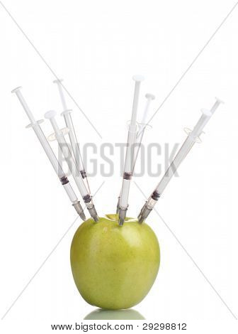 green apple and syringes isolated on white
