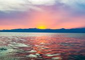 Red Sunset On Lake Kivu, Rwanda. Waves On The Sea And The Glowing Sun Dropping Over The Horizon In T poster