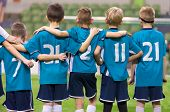 Young Football Players. Young Soccer Team Supporting Friends During Penalty Kicks. Soccer Match For  poster