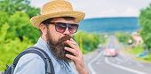Quit Smoking Journey. Man With Beard And Mustache In Straw Hat Smoking Cigarette, Road Background De poster