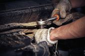 Hands Of Car Mechanic With Wrench In Garage poster