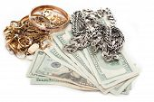 gold and silver pile scrap and cash dollar