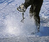 foto of ice fishing  - drilling a hole through the ice with an auger - JPG