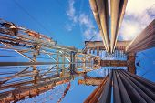 Onshore Land Rig In Oil And Gas Industry. Oil Drilling Rig Against A Blue Sky With Clouds poster