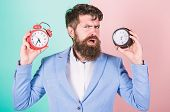 Guy Unshaven Puzzled Face Having Problems With Changing Time. Time Zone. Does Changing Clock Mess Wi poster