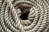 The Thick Rope Twisted In A Roll. The Top View On A Rope Spiral. The Rope Curtailed Into A Circle. T poster