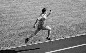 Athlete Run Track Grass Background. Sprinter Training At Stadium Track. Runner Captured In Midair. S poster