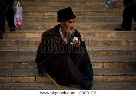 Beggar Receives Alms On Mosque Steps
