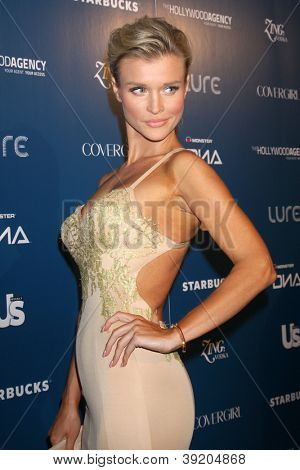 LOS ANGELES - NOV 18:  Joanna Krupa arrives for the US Weekly AMA After Party at Lure on November 18, 2012 in Los Angeles, CA