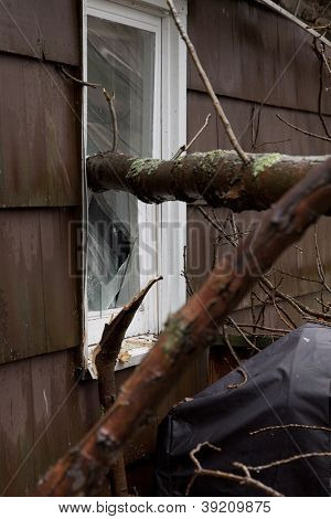 ANDOVER, NJ - OCT 30: A broken window pane from outside a home struck by falling trees after Hurricane Sandy made landfall in the northeast region of the US in Andover, New Jersey on October 30, 2012.