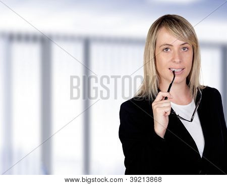 Pensive businesswoman with glasses in the office