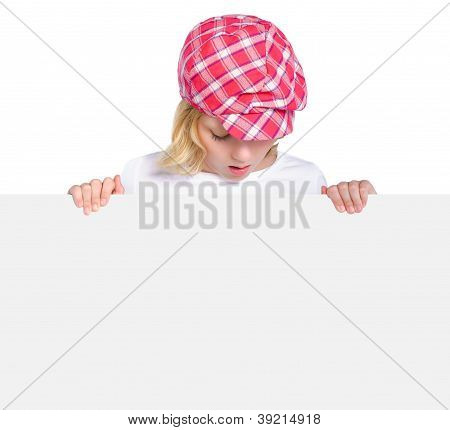 Overwhelmed Teen Girl Looking On Big Poster Isolated Over White