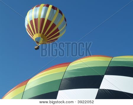 Two Hot Air Balloons In Flight