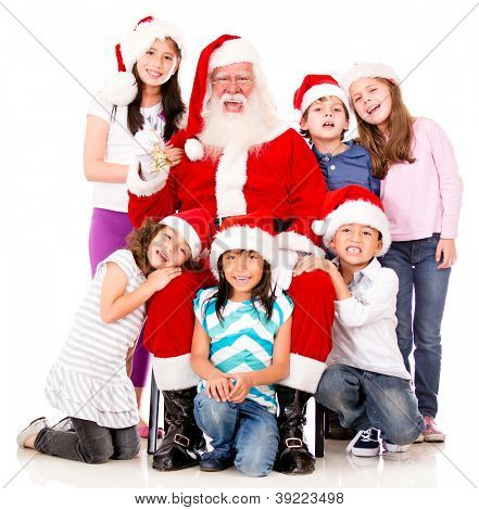 Happy Santa with a group of Christmas kids - isolated over white