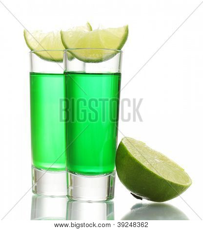 glasses of absinthe and lime isolated on white