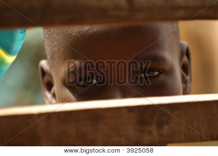 African Boy Through Bars