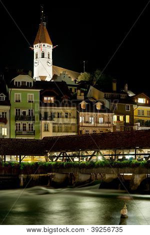 Bridge And Buildings In Thun At Night