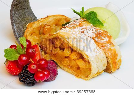 Strudel With Raisins, Fresh Berries And Ice Cream