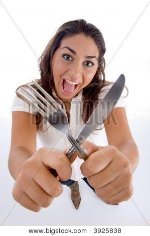Cute Teenager Showing Cutlery
