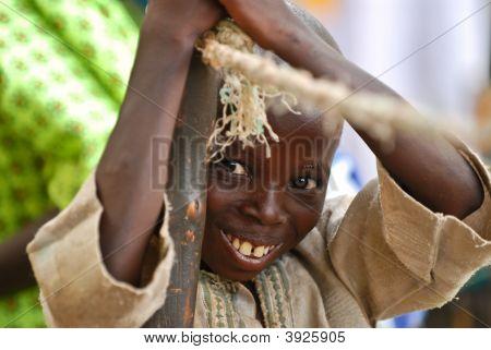African Boy Wooden Pole