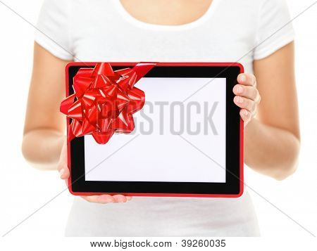 Tablet computer screen gift. Closeup of touch pad tablet computer screen with red gift ribbon. Christmas gift or present isolated on white background.