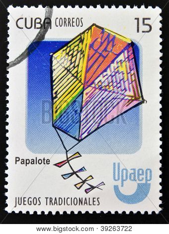 CUBA - CIRCA 2010: A stamp printed in Cuba dedicated to traditional games shows a kite (papalote) ci