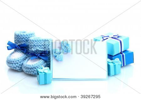 beautiful gifts, baby's bootees and blank postcard, isolated on white