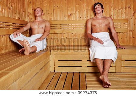 Two men sitting relaxed in a steam sauna