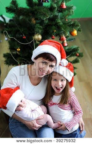 Happiness family in red christmas hats