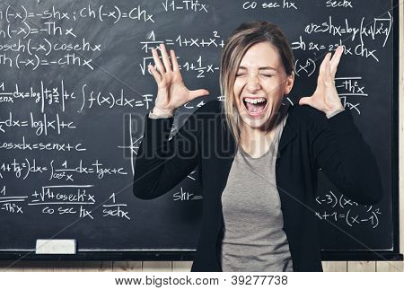 portrait of stressed teacher and blackboard background