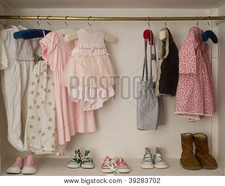 baby girl cute closet with handing dress and boots