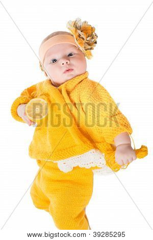 Portrait Of  Baby Girl With Yellow Flower On Her Head On  White Background