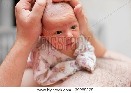 Newborn Baby In The Hands Of The Dad