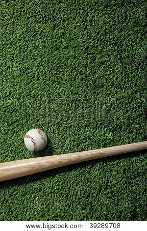 Overhead View Of Baseball And Bat On Green Turf