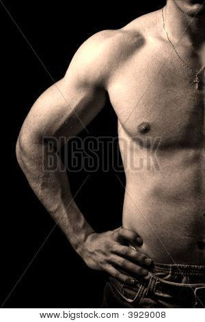 Muscular Guy On Black Background