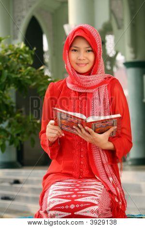 Muslim Girl Holding Qur'an