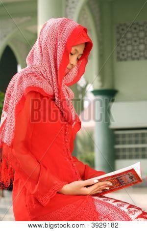 Muslim Girl Reading Koran