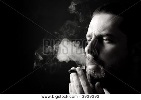 Male Smoker In The Dark