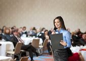 foto of training room  - Beautiful business woman is speaking on conference - JPG