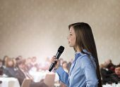 image of public speaking  - Beautiful business woman is speaking on conference - JPG