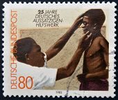 GERMANY - CIRCA 1982: A stamp printed in Germany dedicated to year German aid to lepers shows doctor