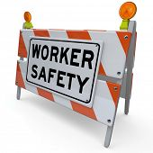 An orange and white blockade with the words Worker Safety to represent danger, warning and caution i